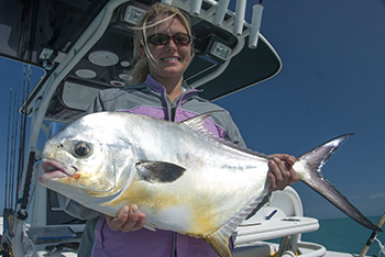 Female angler holds up a nice wreck permit caught in the Dry Tortugas